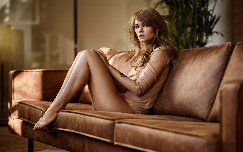 women, brunette, couch, legs, sitting, tanned, tattoo, blue eyes, looking at viewer, Anastasia Scheglova, Sacha Leyendecker