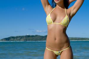 ac0f0f0ac7ab5 women model sea arms up wet body polka dots bikini yellow bikinis pierced  navel swimwear clothing