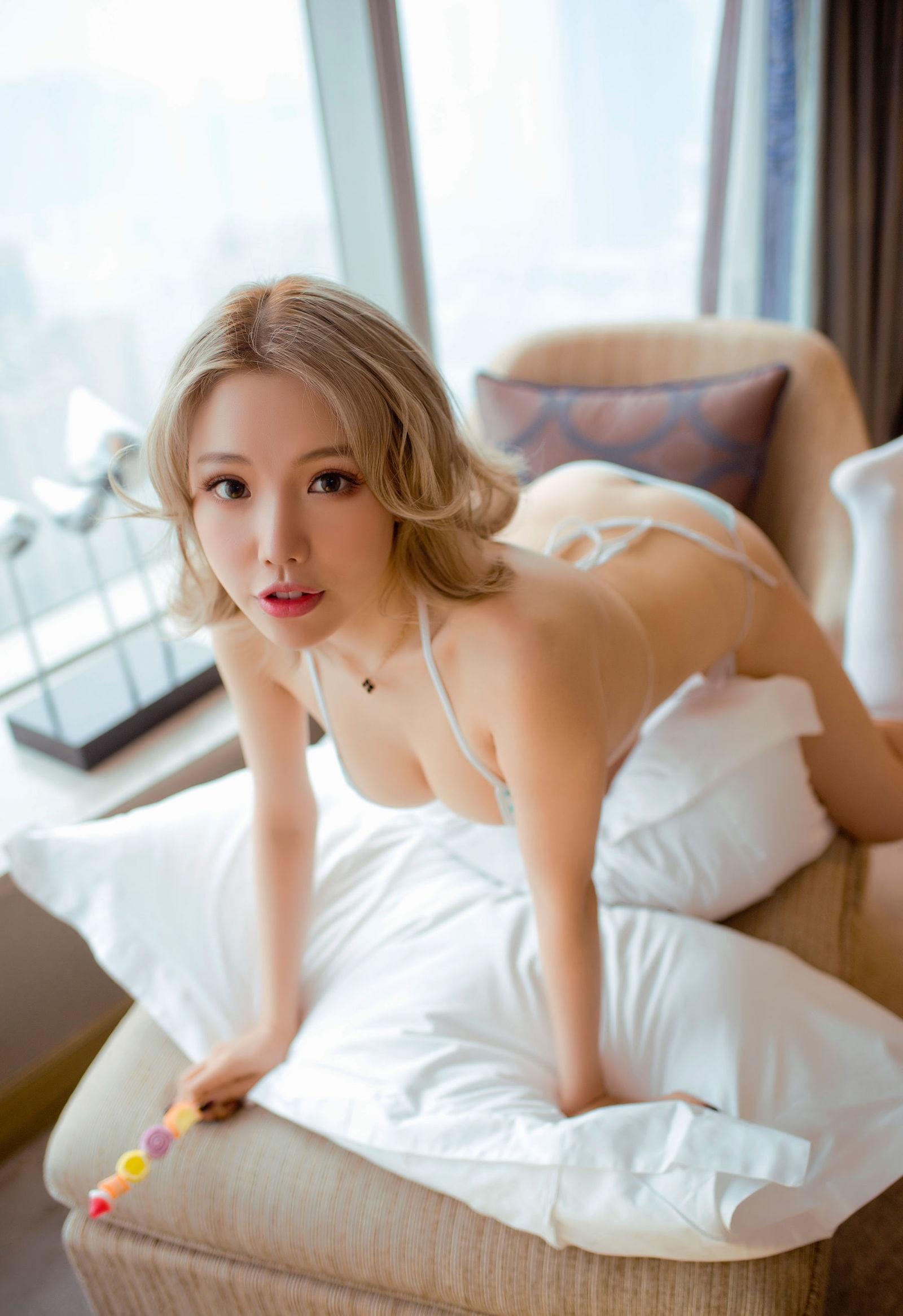 Asian bending over