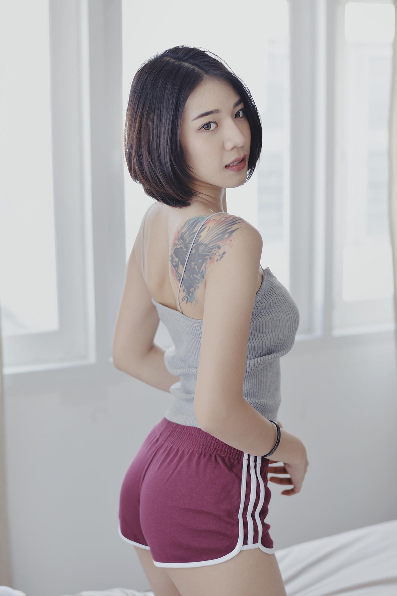 Wallpaper Model Brunette Asian Looking At Viewer Portrait Display Inked Girls Tattoo Tank Top Short Shorts Standing Window Depth Of Field Women Indoors 1365x2048 Wizigoths 1541489 Hd Wallpapers Wallhere