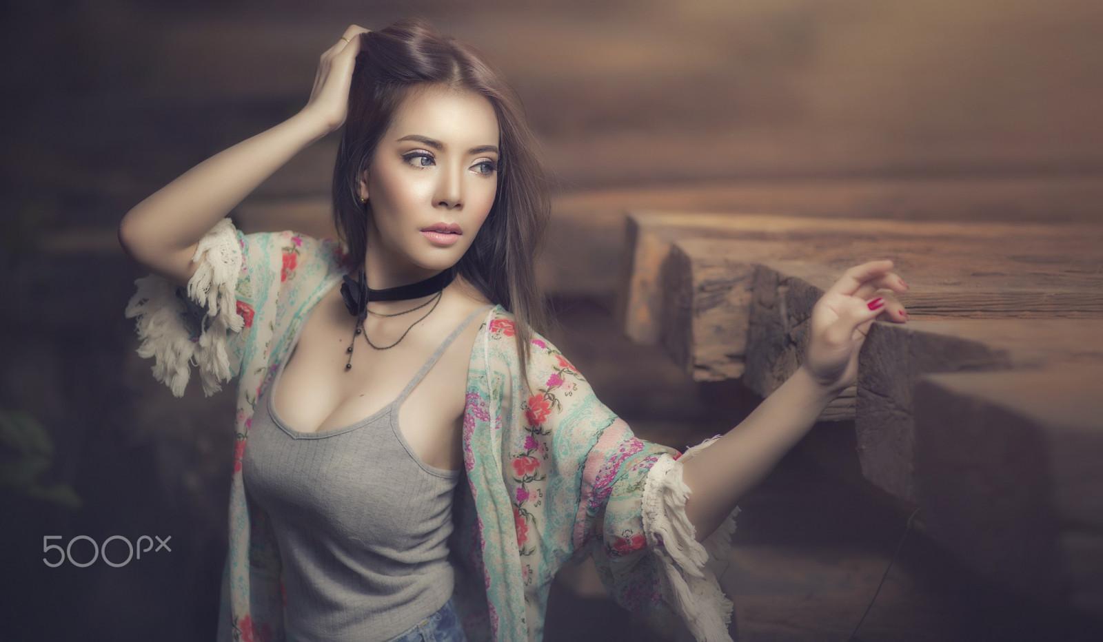 Asiatisk datingside store bryster bilder