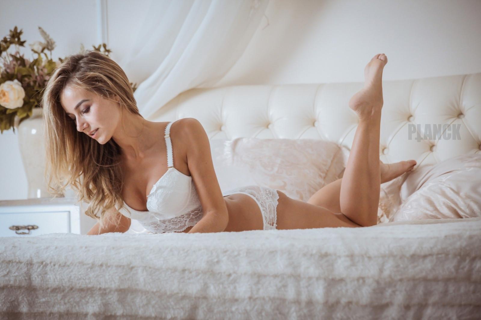 Blonde girl in bed